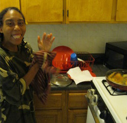 Alvena Wilson in the kitchen of the new apartment she moved into after a fire.
